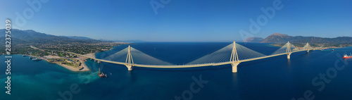 Photo sur Aluminium Ponts Aerial drone panoramic photo of world famous cable suspension bridge of Rio - Antirio Harilaos Trikoupis, crossing Corinthian Gulf, mainland Greece to Peloponnese, Patras