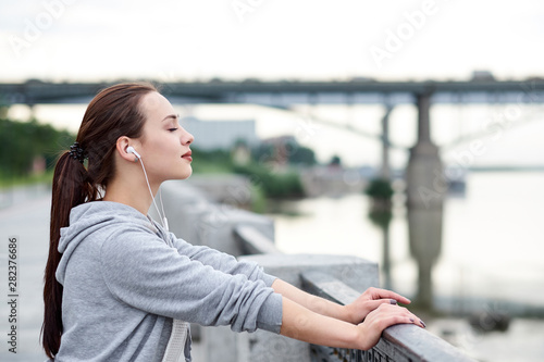 Canvastavla Fitness healthy asian woman runner relaxing after running outdoors enjoying view