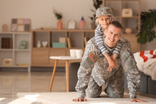 Happy Military Man Playing With His Daughter At Home
