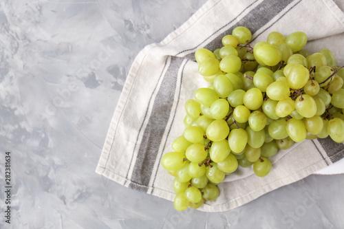 Tasty fresh grapes on grunge background Wallpaper Mural