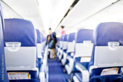Photo blurred passenger and airhostess