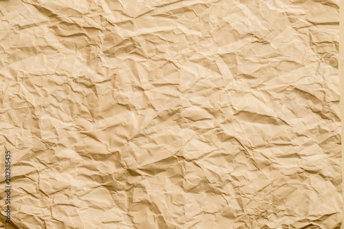 Brown crumpled paper sheet. Creative minimalist design. Abstract art background. Copy space.