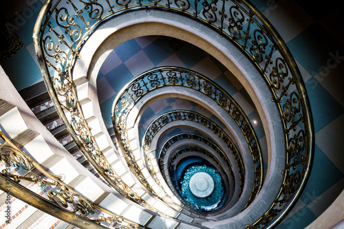 Cuadros en Lienzo Spiral staircase from top to down decor design in Europe style.