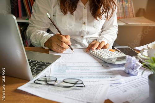 Fotografia Budget planning concept, Accountant is calculating company's annual tax