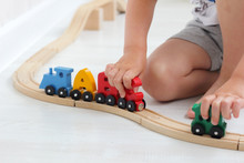 Boy Plays With Letters Of Alphabet Train On Rails In Children's Playroom. Steam Train Colorful Wagons; Wooden Toy Made Of Natural Ecofriendly Material. Early Childhood Development Learning To Read