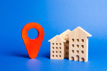 Houses And Red Navigation Pointer Pin. Location Of Residential Buildings Or Work, City Orientation. Checking The Location Of A New Apartment For Infrastructure Facilities, Parks And Other.