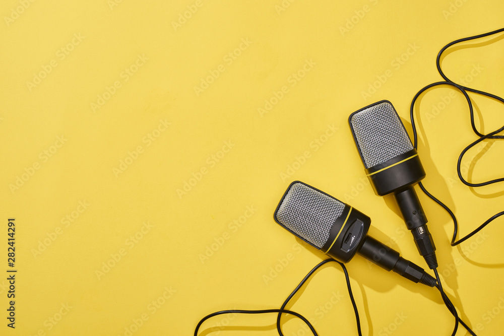 Fototapety, obrazy: top view of microphones on bright and colorful background with copy space