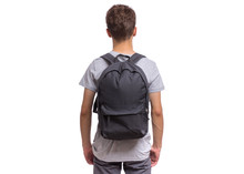 Student Teen Boy With Backpack - Back View. Portrait Of Cute Schoolboy With Hands In Pockets, Isolated On White Background. Happy Child Back To School - Rear View.