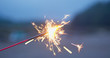 Play with sparklers in the summer time at outdoor