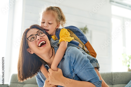 Fotografia  Parent and pupil of preschool.
