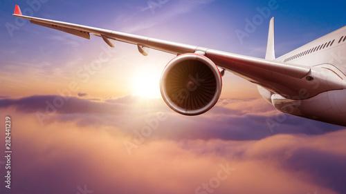 Fototapeta Detail of passengers commercial airplane wing obraz