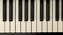Close-up Of A Dirty Old Vintage Effect Piano Keyboard