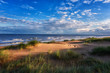 Leinwandbild Motiv Amazing nature landscape with sand dunes, green grass, sea and fantastic blue sky with clouds. Natural outdoor travel background, Northern sea, Netherlands