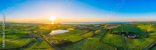 Fotografia, Obraz aerial panoramic view of summer countryside sunset,Northern Ireland