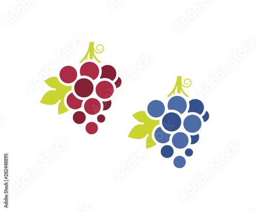 Red grapes and blue grapes. Icon set. Fresh fruit with leaves on white background Fototapete