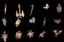 Amulets With Scandinavian Runes And In The Form Of Animals On A Black Background. Antique Metal Pendants, Close-up.