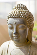 Sunlit Statue Of Buddha