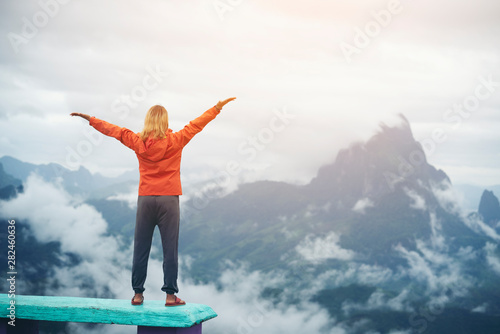 Foto  Woman open arms with nature background