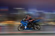 Motorcycle Rider Racing At High Speed