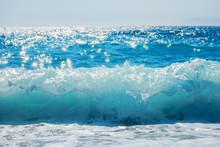 Breaking Wave Of Blue Ocean On Sandy Beach Summer Background