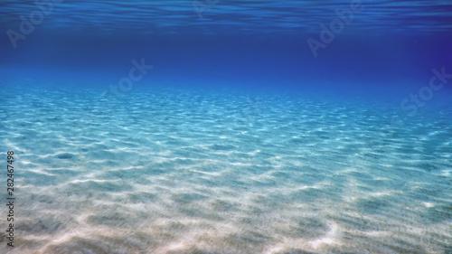 Underwater Blue Ocean, Sandy sea bottom Underwater background Canvas Print