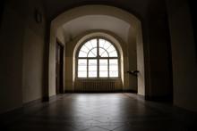 Half-round Vintage Window In A Dark Corridor Of An 18th Century Building.