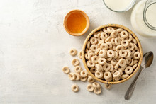 Whole Grain Cereal Rings In Bowl On Concrete Background. Healthy Breakfast. Top View. Copy Space.