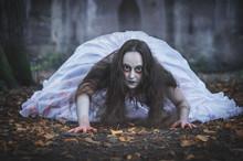 Creepy Dead Bride Crawling. Halloween Scene