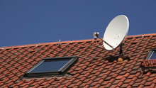 Satellite Dish On Red Roof