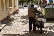 Homless Man Pushing His Packed Bike, Homles Man From Behind, Poverty, Homelessness
