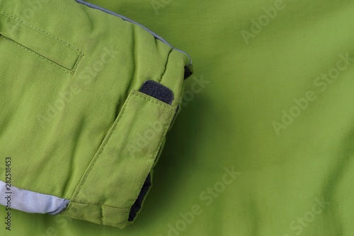 Fototapeten Natur green fabric texture from the sleeve to the part of the jacket
