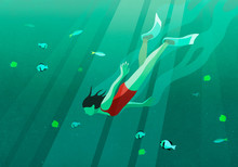 Woman Swimming Underwater In Ocean Surrounded By Fish
