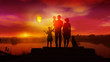 Family with children watches on launched Chinese lantern at sunset
