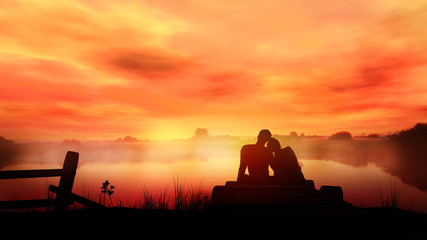 Loving couple on red sunset...