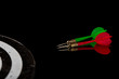 Colored arrows on a black background and target. Hit the target