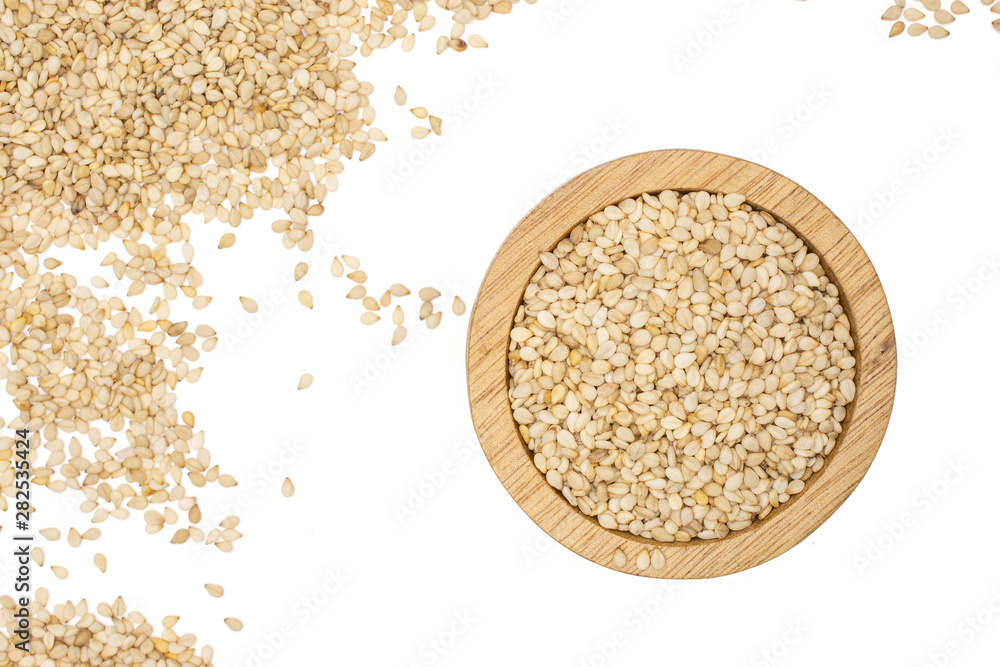 Fototapety, obrazy: Lot of whole unpeeled sesame seeds in wooden bowl flatlay isolated on white background