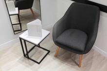 Grey Armchair And Minimalistic...
