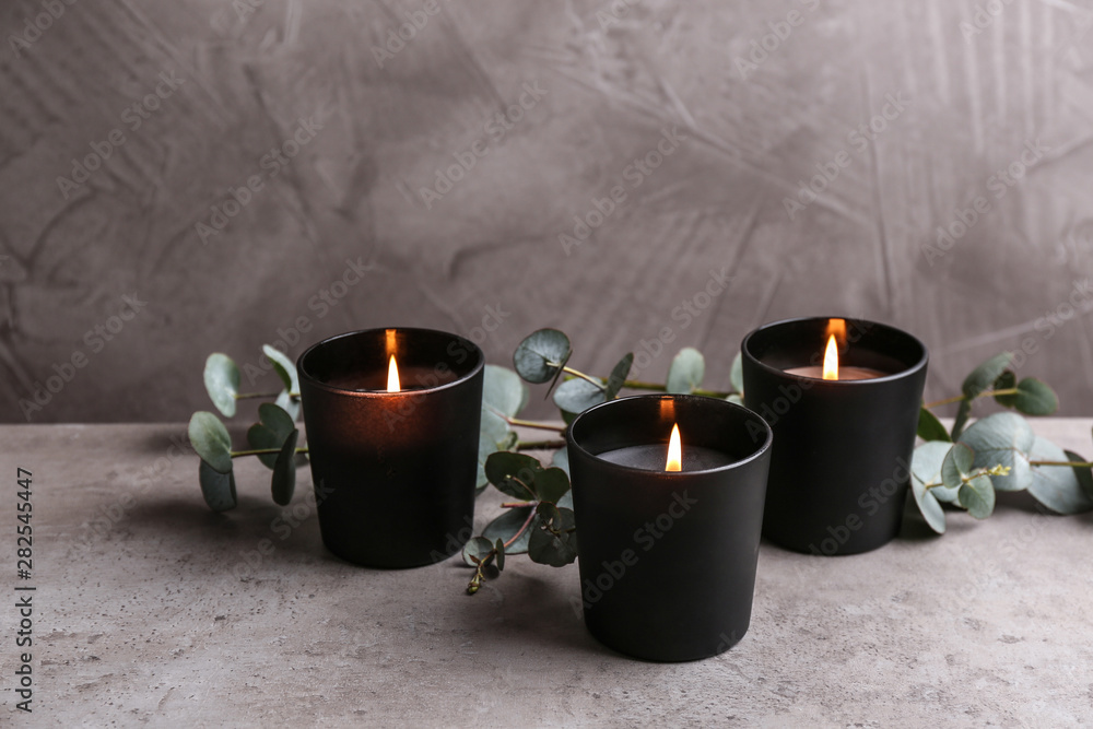 Fototapety, obrazy: Burning candles and green branches on table