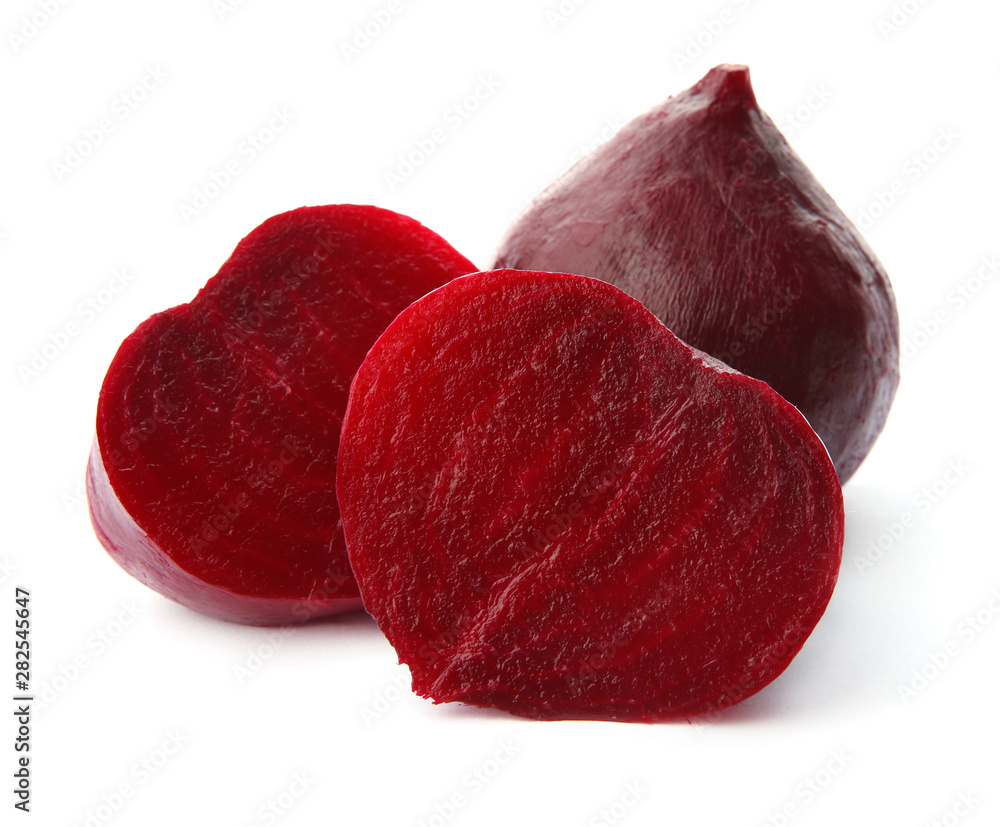 Fototapety, obrazy: Whole and cut boiled red beets on white background