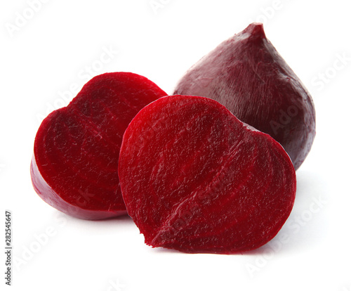 Fotografie, Obraz  Whole and cut boiled red beets on white background