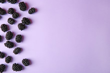 Tasty Ripe Blackberries On Purple Background, Flat Lay. Space For Text