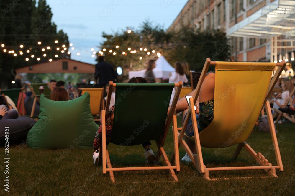 Fotografie, Obraz Modern open air cinema with comfortable seats in public park