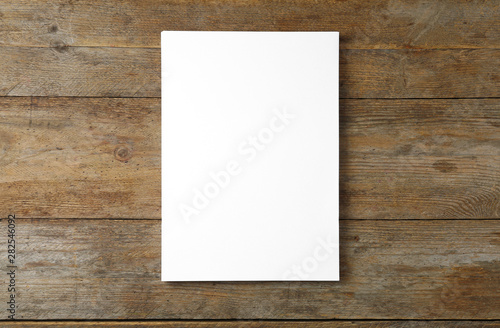 Cuadros en Lienzo  Stack of blank paper sheets for brochure on wooden background, top view
