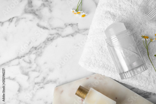 Photo Flat lay composition with natural crystal alum deodorant and space for text on w