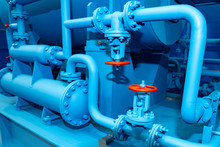 Blue Pipes With Red Valves. Industrial Equipment. Red Valves On The Pipes. Fuel Production. Pipes With Valves For Gas Supply. Gas Distribution System. Liquefied Natural Gas. Fuel Industry.