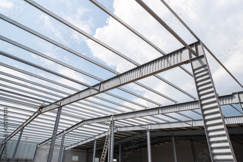 Fototapeta industrial building frame, metal supports and partitions for construction and roof obraz