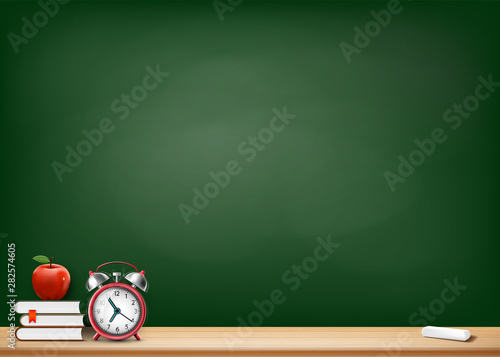 Background with blackboard books alarm clock and apple