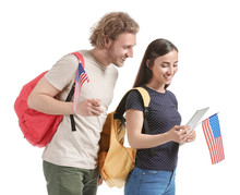 Young Students With USA Flags And Tablet Computer On White Background