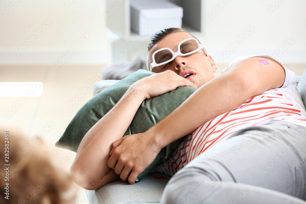 Fototapety, obrazy: Young man sleeping after party at home
