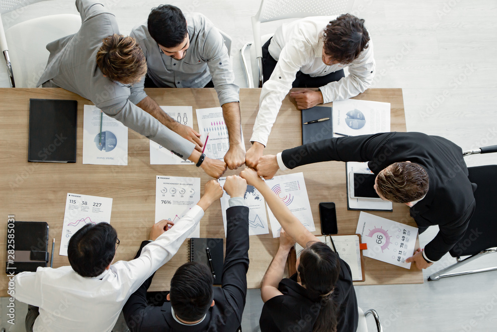 Fototapeta Top view join hands of team of Asian people and foreigners.